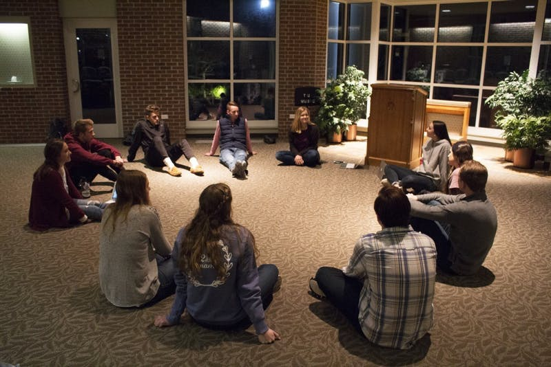 Gathered in the prayer chapel, the startup IJM club members discuss goals and events.