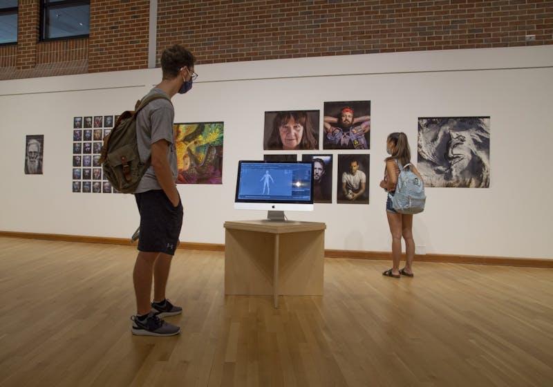 Students view contributing artist Ian Spriggs's CGI Portraits in Art Machina.
