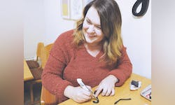 Senior Rachel Chambers makes jewelry for Shop the Loop.