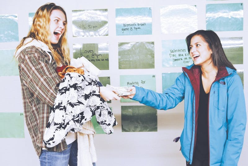 (From left to right) Sophomore Hannah Thalmayer and freshman Cristel Reyes participate in closet sale.