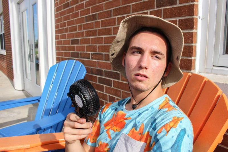 Sophomore JD Groh, who lives in Wengatz Hall, attempts to cool down.