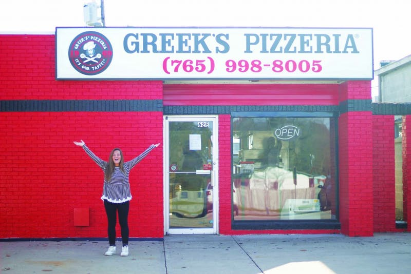 Kaitlyn Kennedy waits for Greek's to open it's doors in December. (Photograph by Riley Hochstetler)