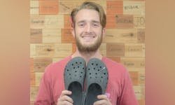 Drew Shriner poses with his Crocs.