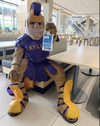 Taylor Trojan prepares for a sanitized study session.
