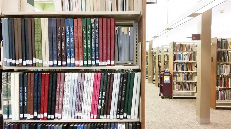 "Two copies of every Taylor University ""Gem"" and ""Ilium"" can be found on the top level of Zondervan Library. (Photograph by Andrew Hoff)"