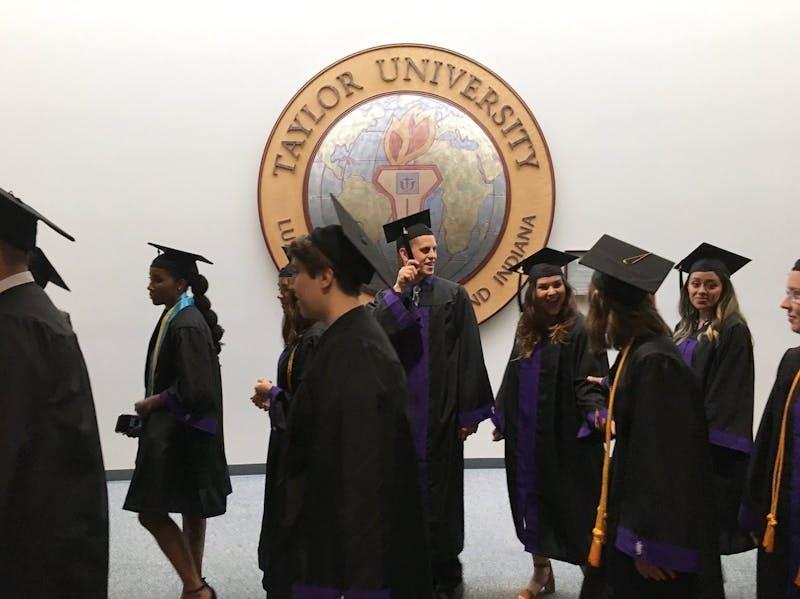 Taylor seniors prepare to walk at graduation