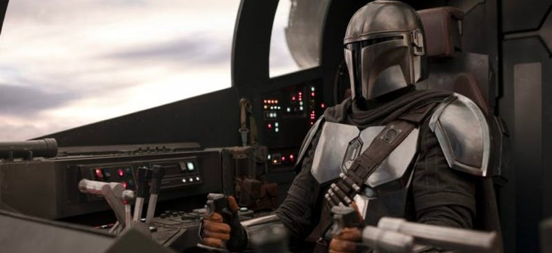 The Mandalorian, played by Pedro Pascal, pursues a mysterious cargo