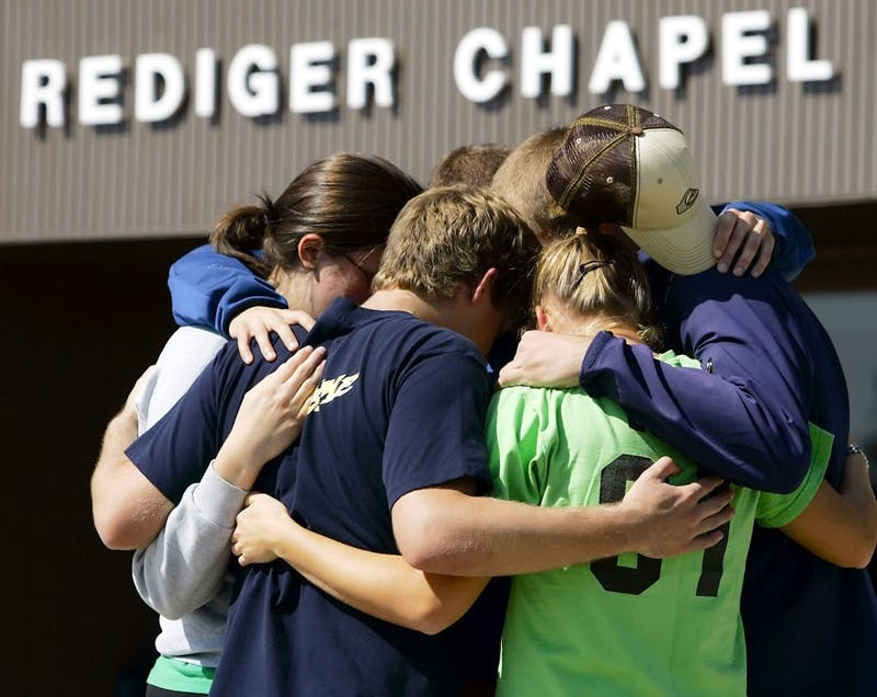 Students gathered to comfort each other after the tragedy. (Photo provided by Michael Conroy of Associated Press)
