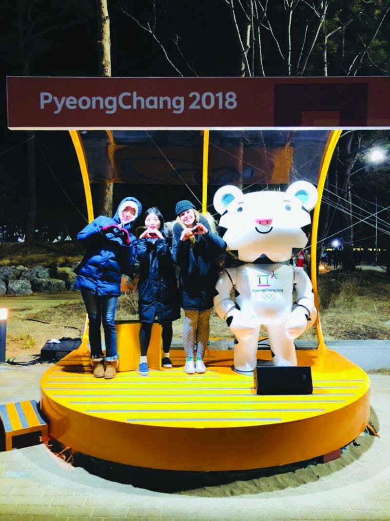 Senior Bethany Russell, and Taylor graduates Inyoung Baek and Jihyun (Bella) Kim pose for a picture at the Pyeongchang Winter Olympics. (Photograph provided by Bethany Russell)