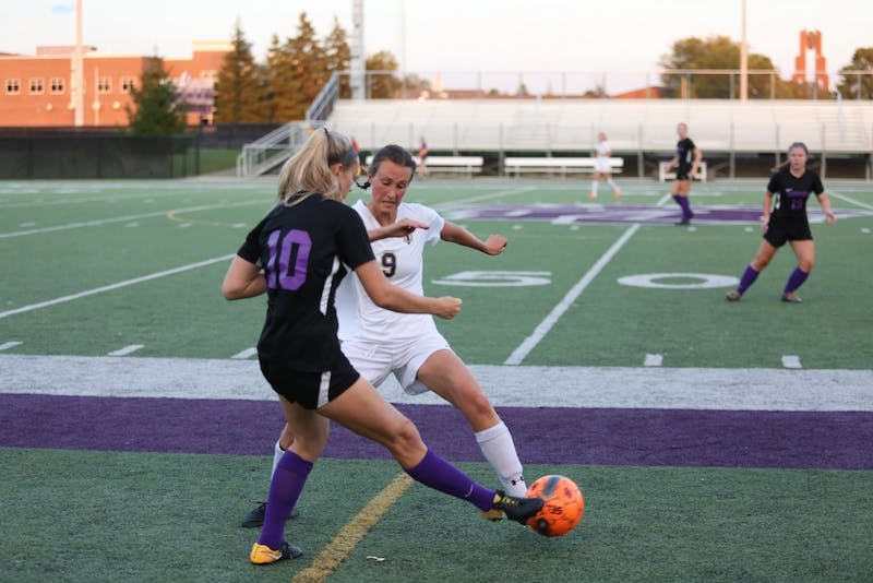 Jourdan Lehman(9) fights for the ball against Indiana Tech. Taylor won 3-1 Friday night.