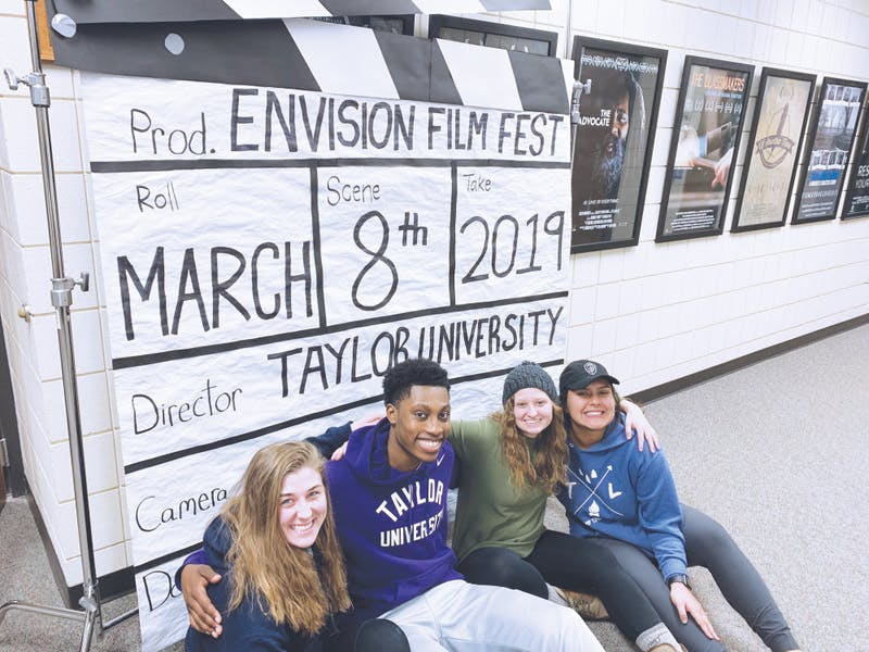 Senior Brianna Jordahl, freshman Brandon Smith, seniors Hannah Goebel and Jackie Hanson prepare for the Envision film festival. Photo by Meagan Bartow.