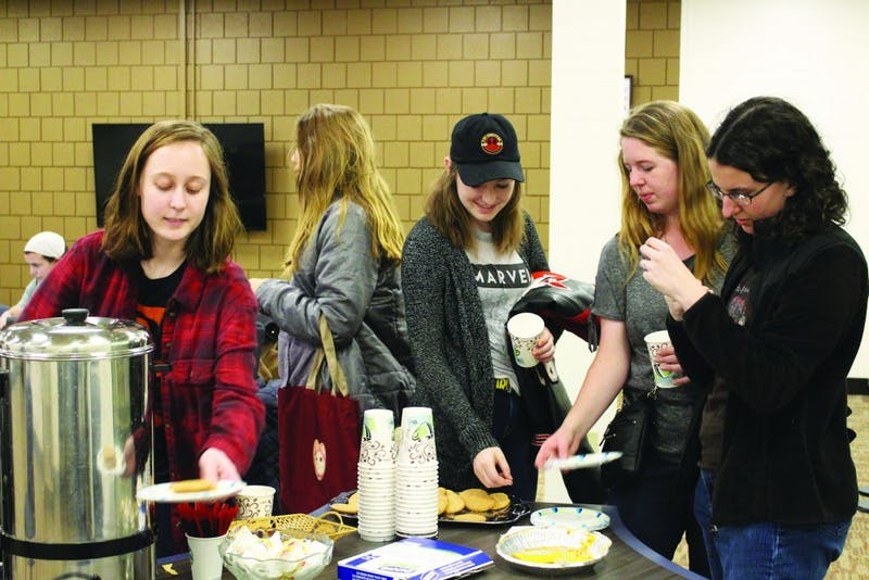 Students get tea, biscuits and fellowship at the C.S Lewis and friends tea event. (Photograph by Ellie Bookmyer)