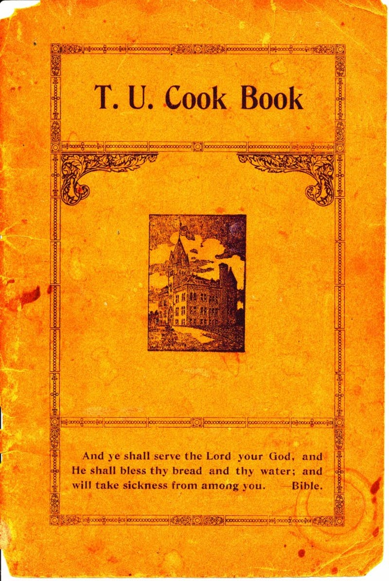 Iris Abbey, Taylor's oldest alumni, provided the Ringenberg Archives and Special Collections with her copy of the T.U. Cook Book published in December 1914. (Photograph provided by Ringenberg Archives and Special Collections)