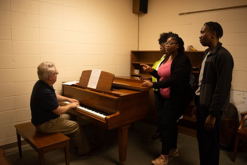 (Left) Clif Davis rehearses with junior Ashton McKenzie, sophomore Alish Withers and junior Timiesha Knowles