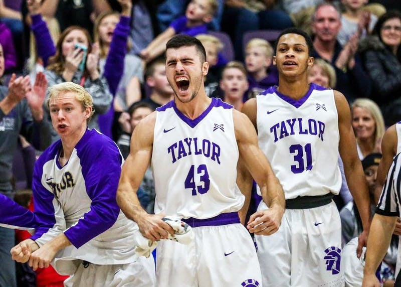 Senior Joe Ingersoll has been a constant supporter of Taylor men's basketball, whether on the sidelines, bench or court. (Photograph by Brad Timmerman)