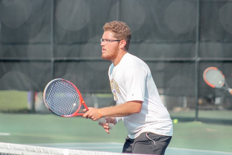 Junior Andre Danelli prepares to return a hit during Saturday's tournament.