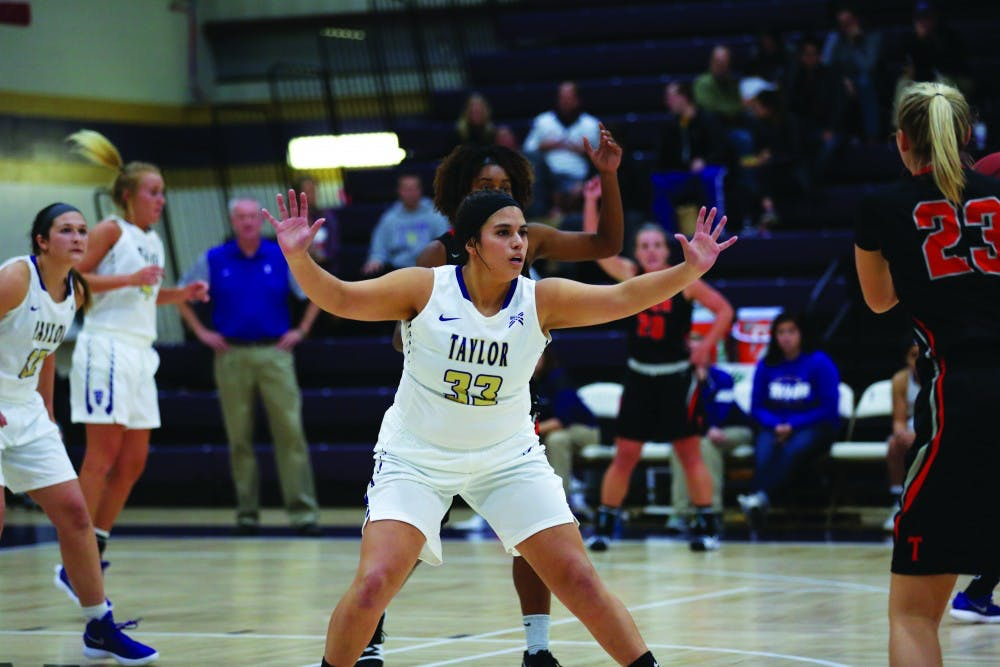 Trojans roll over Cougars with ease