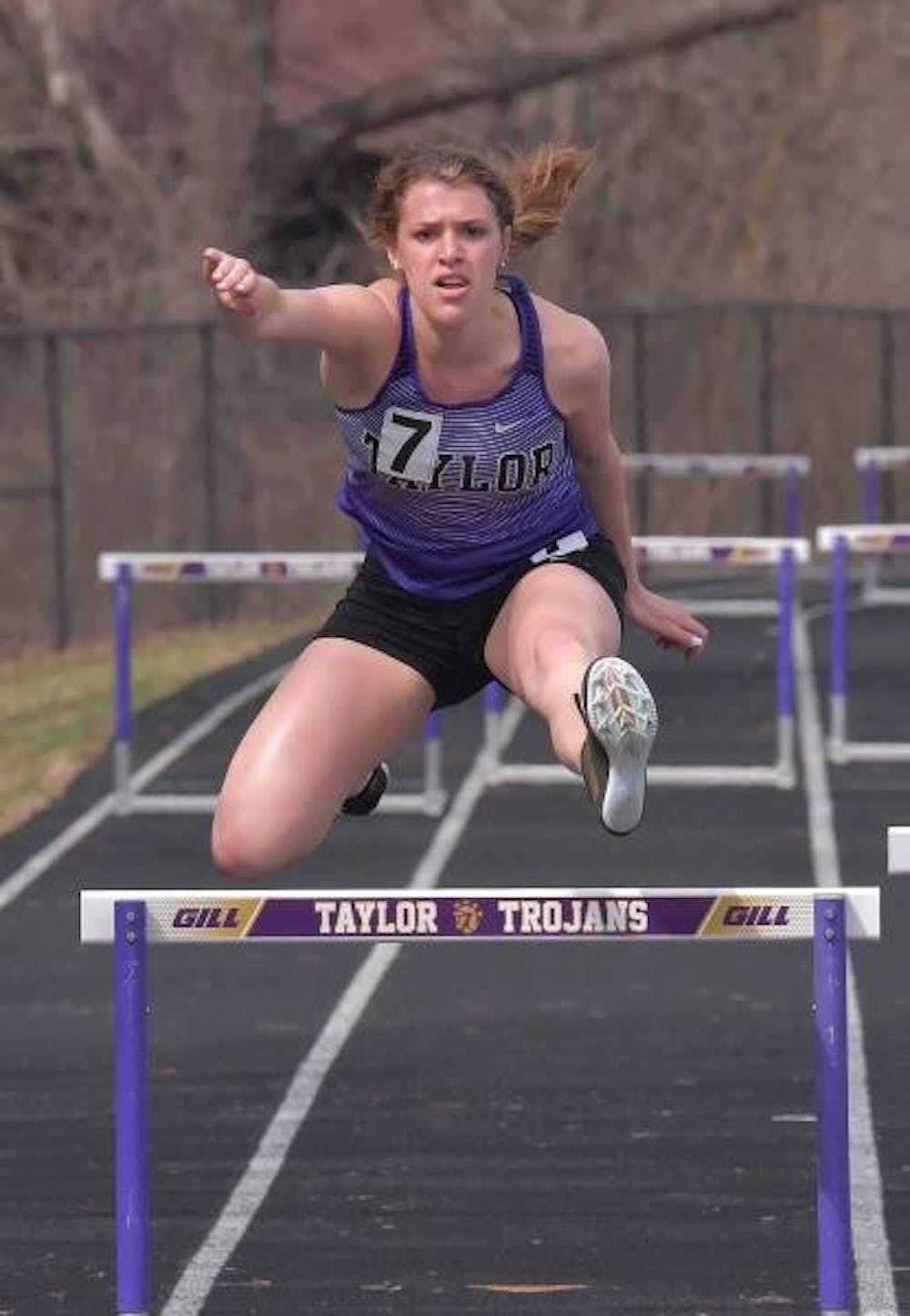 Women's track and field competes at home