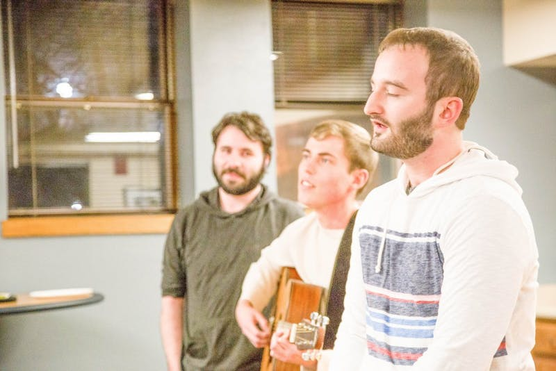 "Juniors Andrew Carter, Tim Hotchkiss and senior Steven Vermillion sing ""Billy the Deceased Chicken"" during the shutdown. Photo by Abigail Roberts."