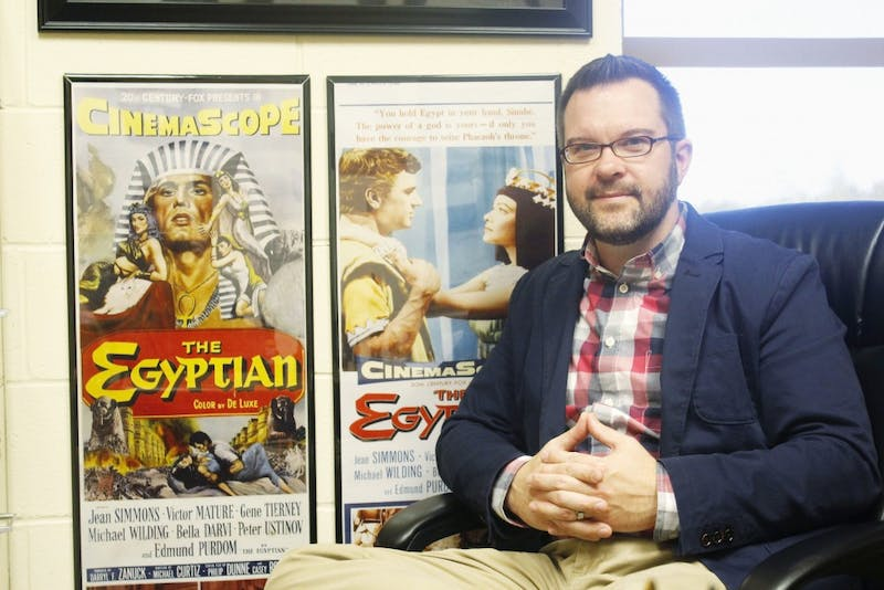 Kevin Johnson, professor of history, brings his love of all things Egypt into his office decor. (Photograph by Riley Hochstetler)