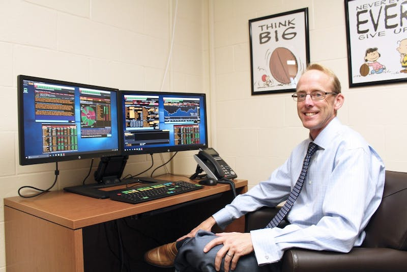 Scott Adams demonstrates the new Bloomberg Business Terminal in his office. (Photograph by Hannah Bolds)