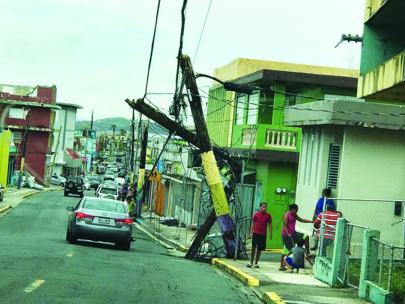 A fallen power line is one of the many damages in Puerto Rico done by Hurricanes Irma and Maria. (Photograph provided by Widaly Martinez)