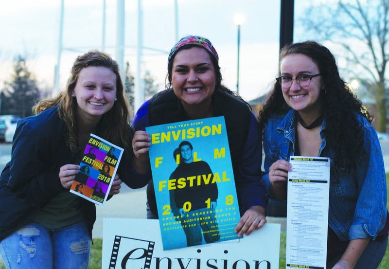 (L to R) Juniors Hannah Goebel and Jackie Hanson and sophomore Kelsea Denney promote the annual Envision Film Festival. (Photograph by Ross Kimbrell)