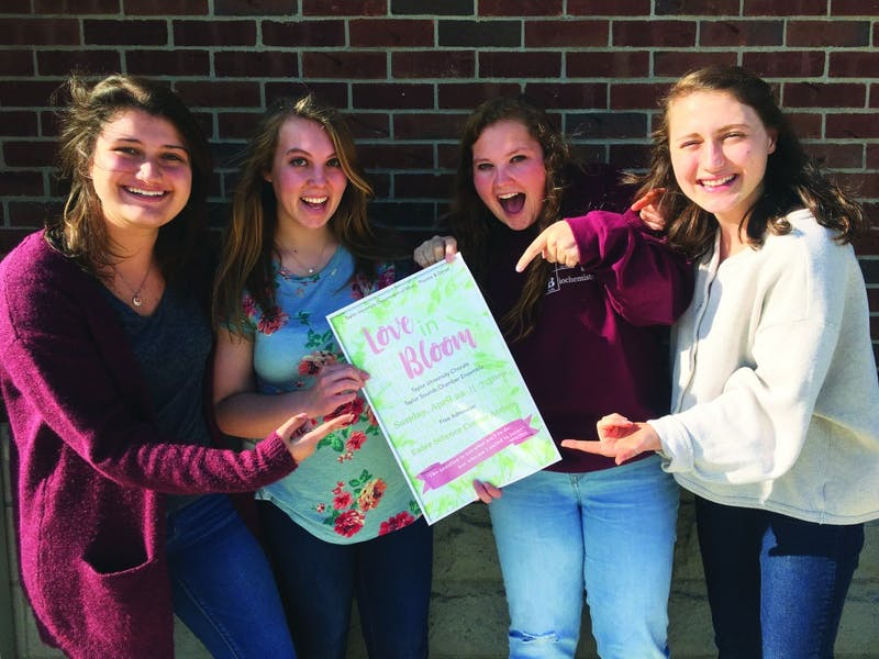 (L to R) Sophomore Paige Wagner, junior Sarah Lynn and sophomores Hannah Ewing and Katie Talbot are excited for the concert. (Photograph by Riley Hochstetler)