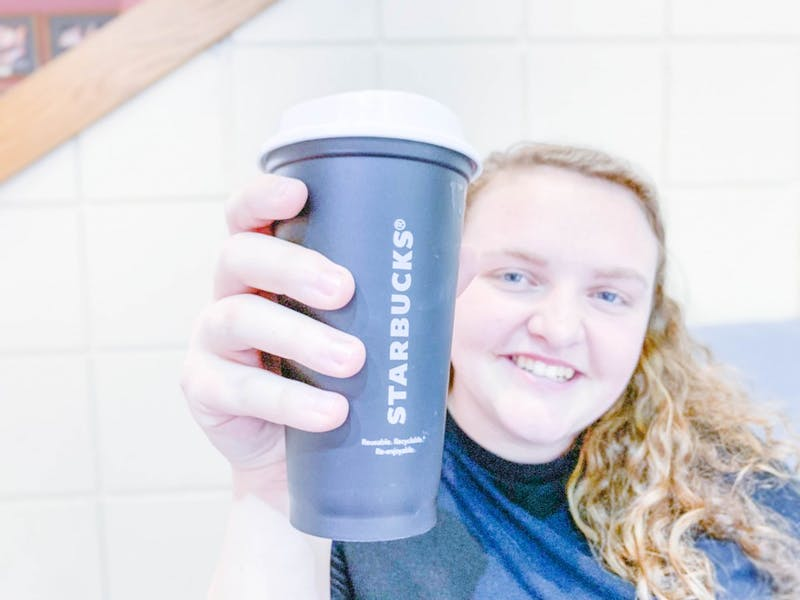 Junior Emily Wallace displays her reusable Starbucks cup. Photo by Jerusha Lindsay.