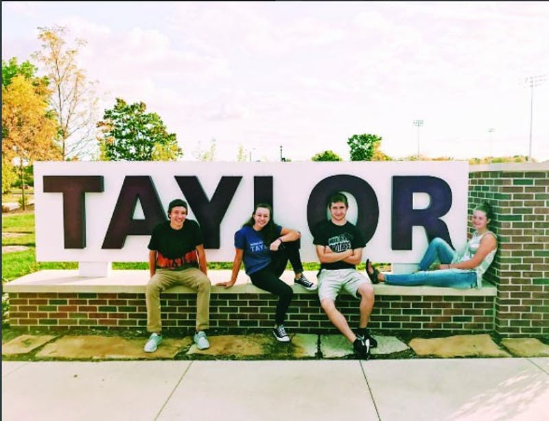 Freshmen Will Ritsema, Elissa Erb, Jacob Ferguson and Lily Walter display their Taylor pride and enthusiasm as they lead the freshman class.