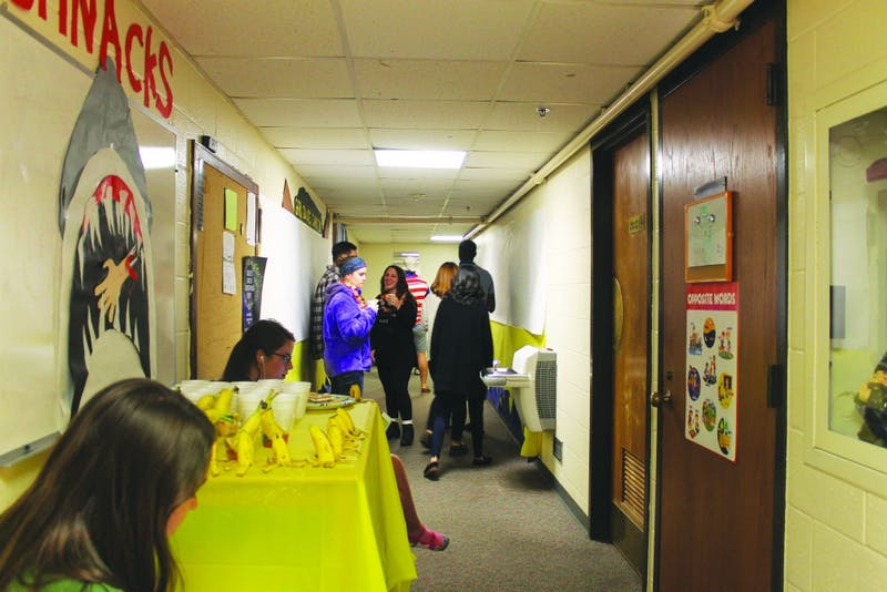 Students congregate by a beverage station. (Photograph by Ruth Flores-Orellana)