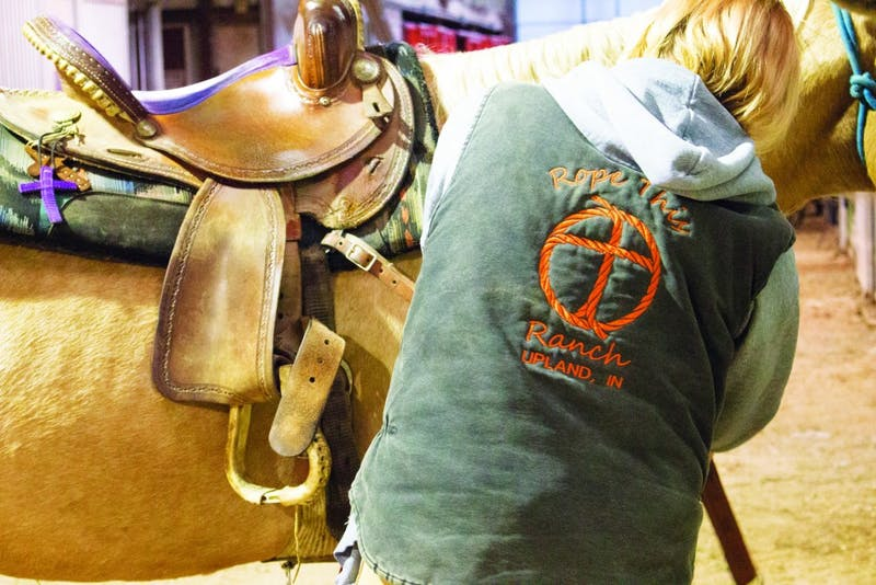 Jenny Schamber, owner and trainer of Rope this Ranch and a counselor at Taylor's Counseling Center, combines her love of horses with her passion for mental and emotional healing. (Photograph by Kassie Joviak)