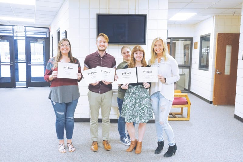 Seniors Grace Hooley and Drew Shriner, juniorAlyssa Roat and seniors Chrysa Keenon and Gabby Carlson received awards from the Indiana Collegiate Press Association.