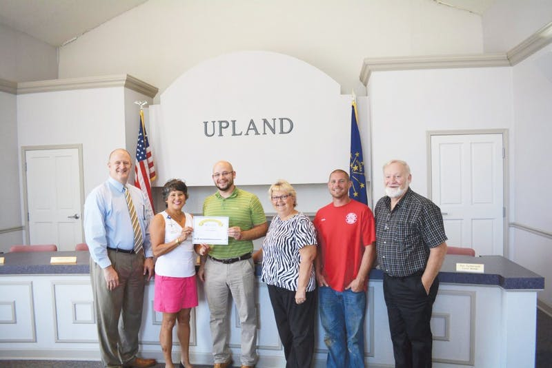 An INDOT representative presents Upland with a certificate award for the Community Crossings grant. Pictured: Councilman Ron Sutherland, INDOT representative Toni Mayo, Town Manager Jonathan Perez, Clerk Jane Rockwell, Street Superintendent Derik Dollar and Council President John Bonham. (Photograph provided by the town of Upland)