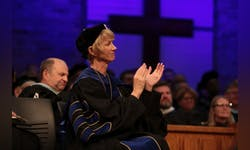 Dr. Paige Cunningham applauds during chapel service.