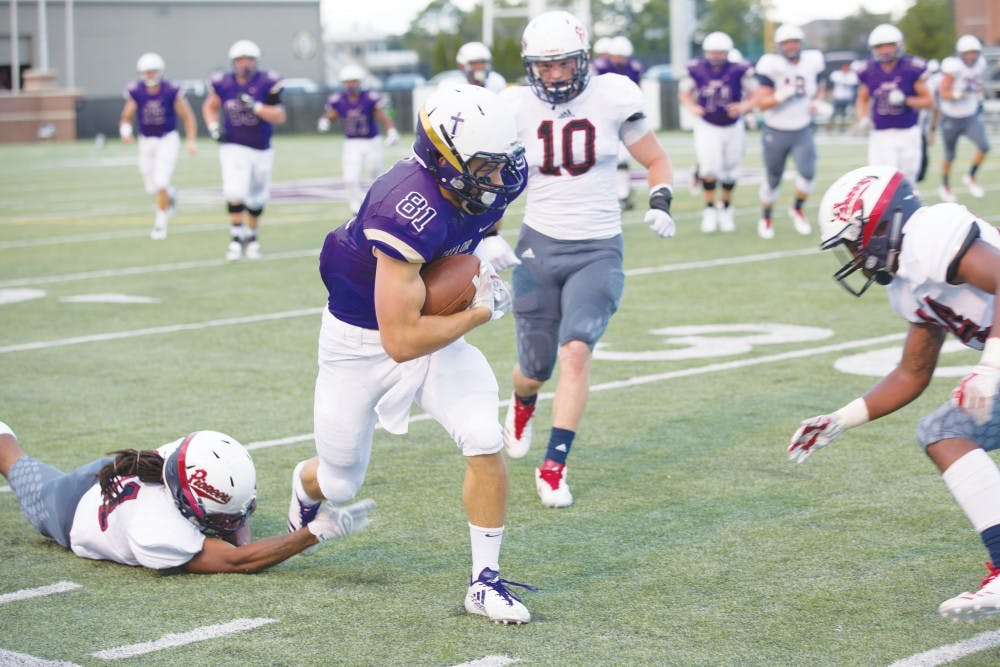 Football wraps up close victory