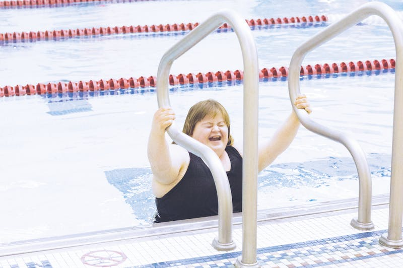 Grant County Special Olympics participant practices in the swimming pool.