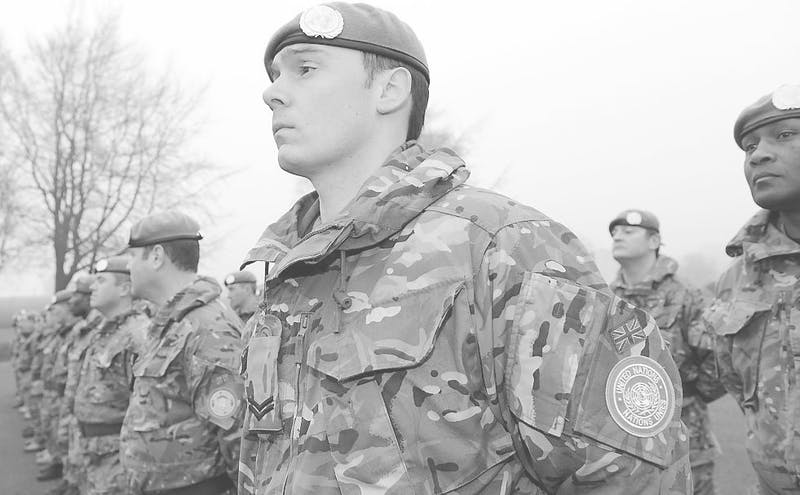 United nation soldiers stand at command.