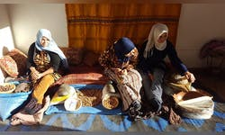 Senior Carissa Zaffiro, shown right, crushes argan beans for oil in the rural area Atlas Mountains of Morocco in Fall of 2018. Zaffiro learned about Islam and interacted with Muslims through her classes and study abroad opportunities at Taylor.