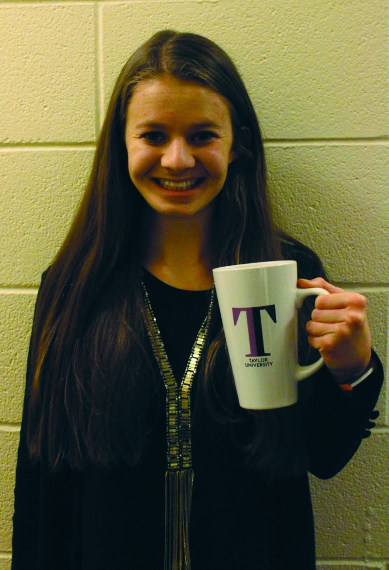 Sophomore Madi Williams smiles with the sophomore class mug which received mixed reviews from recipients.