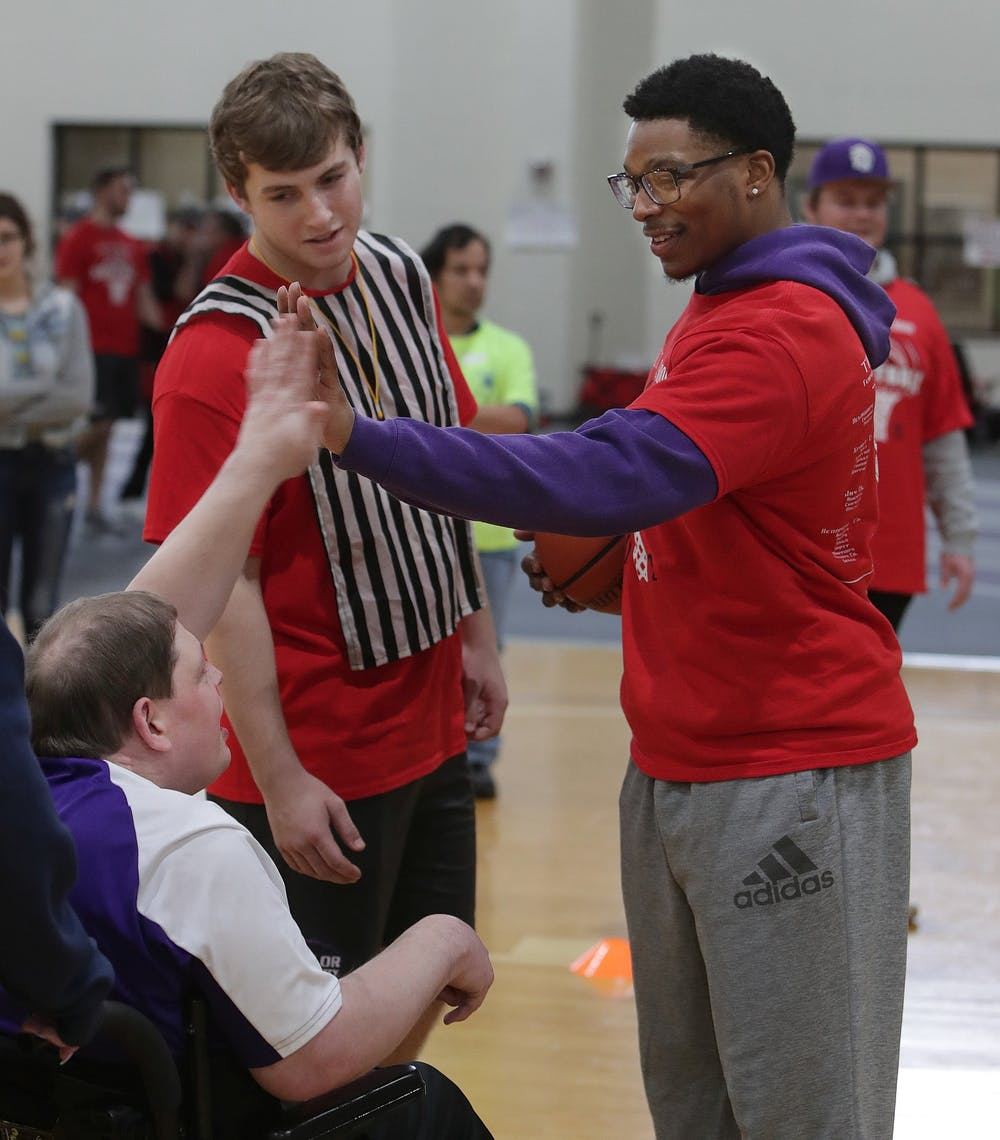 Special olympic athletes take it to the hoop