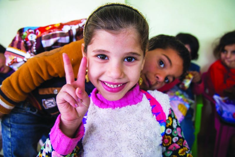 Zahra, a Syrian refugee in Azraq, Northern Jordan represents just one of the 2.6 million Syrian children refugees worldwide. (Photograph provided by Abigail Roberts)