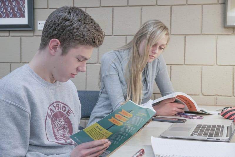 Juniors Max Urban and Katie Turner read up for book club.