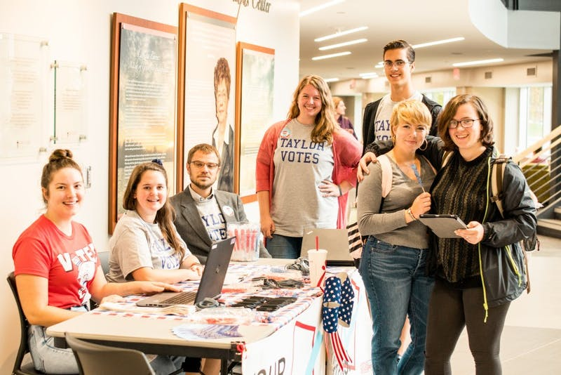 Political science, psycology, and economics students run a voter registration booth on national Voter Registration Day.