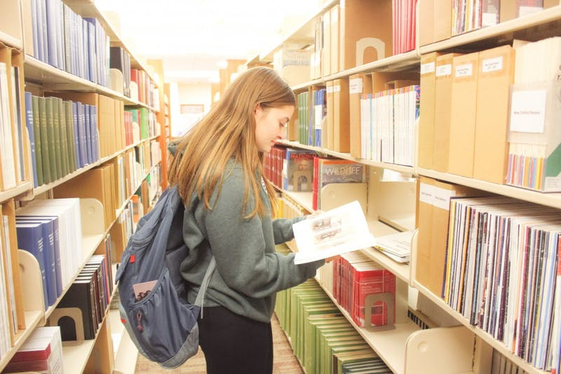 Junior Piper Nicholson peacefully browses the shelves.