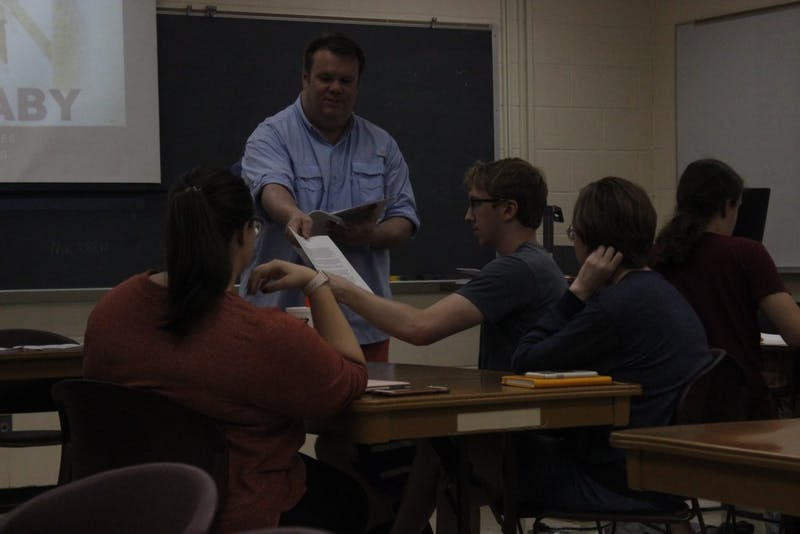 Cecil Stokes, an accomplished screenwriter, teaches upperclassmen about character development during a professional writing class.
