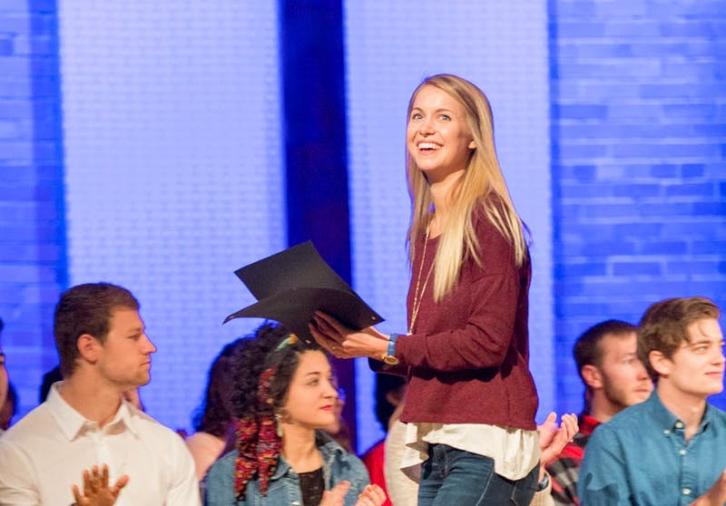 Senior Nicole Arpin received 2017 Student Leader of the Year during honors chapel on Monday. (Photograph by Becca Robb)