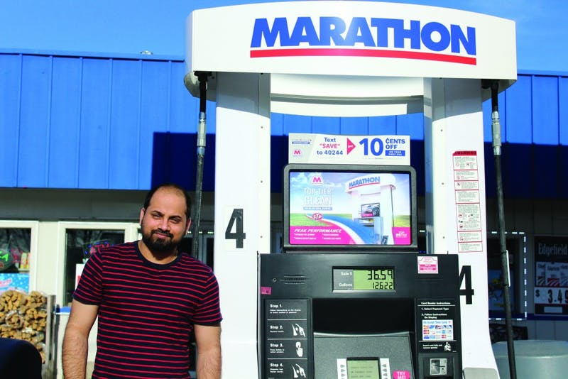 Every year, anxious freshman that have just completed the awk-walk are greeted by Baljinder Singh as they enter his Marathon gas station. (Photograph by Alicia Garnache)