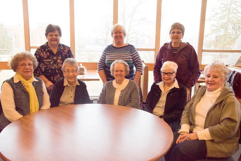 (front row, left to right) Velma Kroeker, Esther Yordy, Liz Williamson, Janie Kesler, (back row, left to right) Lou Roth, Ruth King and Marian Heacock meet every Monday morning.