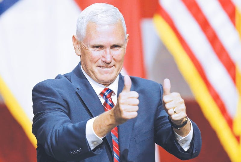 Mike Pence honors Taylor with his attendance.
